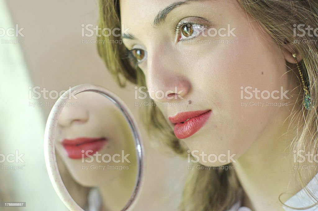 Red lipstick looking in the mirror royalty-free stock photo