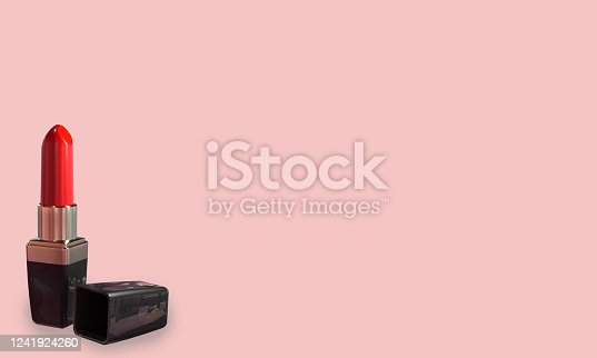 Red lipstick open on a pink background with copy space