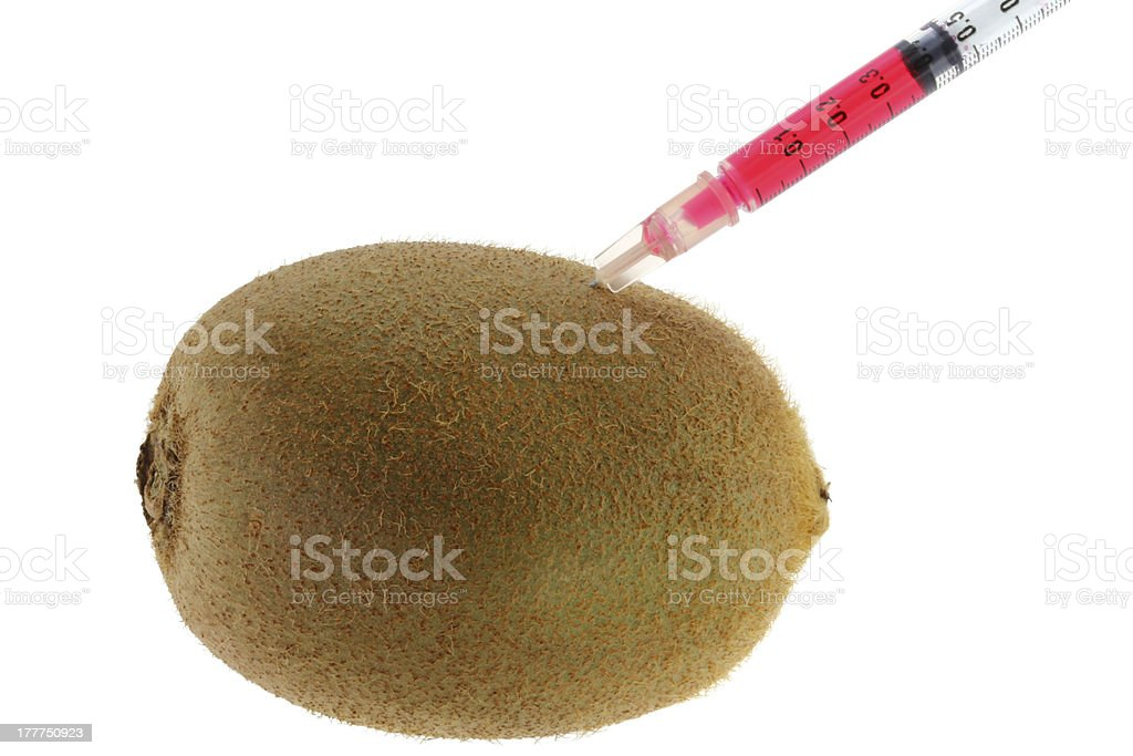 Red Liquid injecting to a Kiwi royalty-free stock photo
