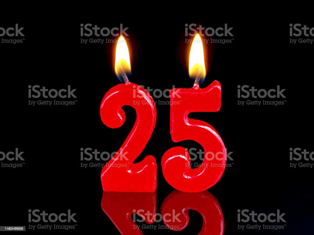 Red lit 25 year anniversary or birthday candles on black stock photo