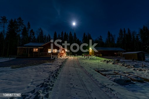 red little cabin in moon light and snow december 22 2018