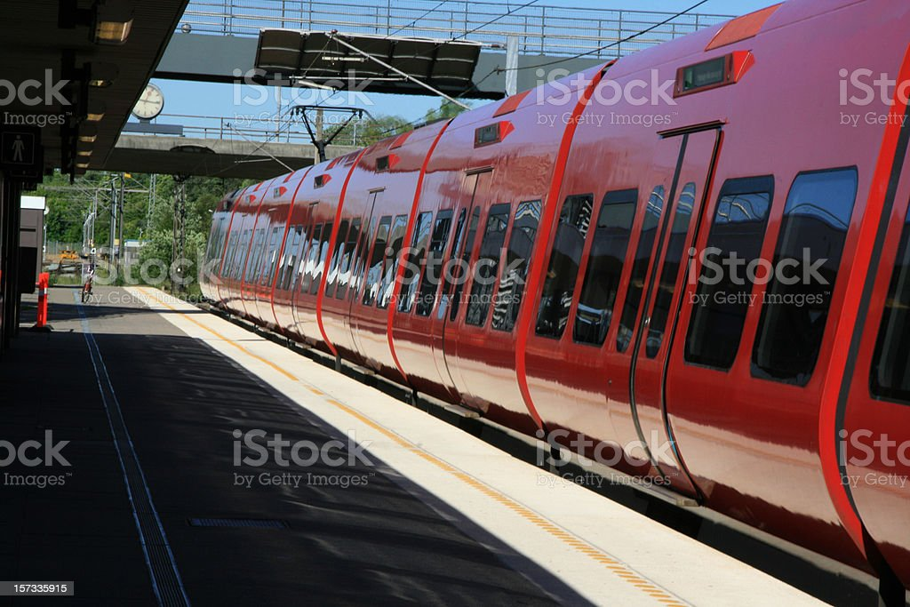 Red local train on Taastrup Station in Denmark royalty-free stock photo