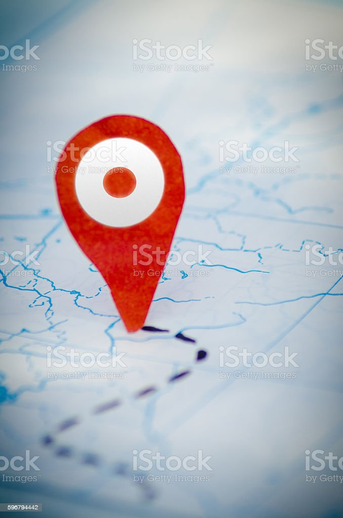 Red locator symbol on a map stock photo