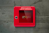Red lock box with glass to be broken in case of emergency