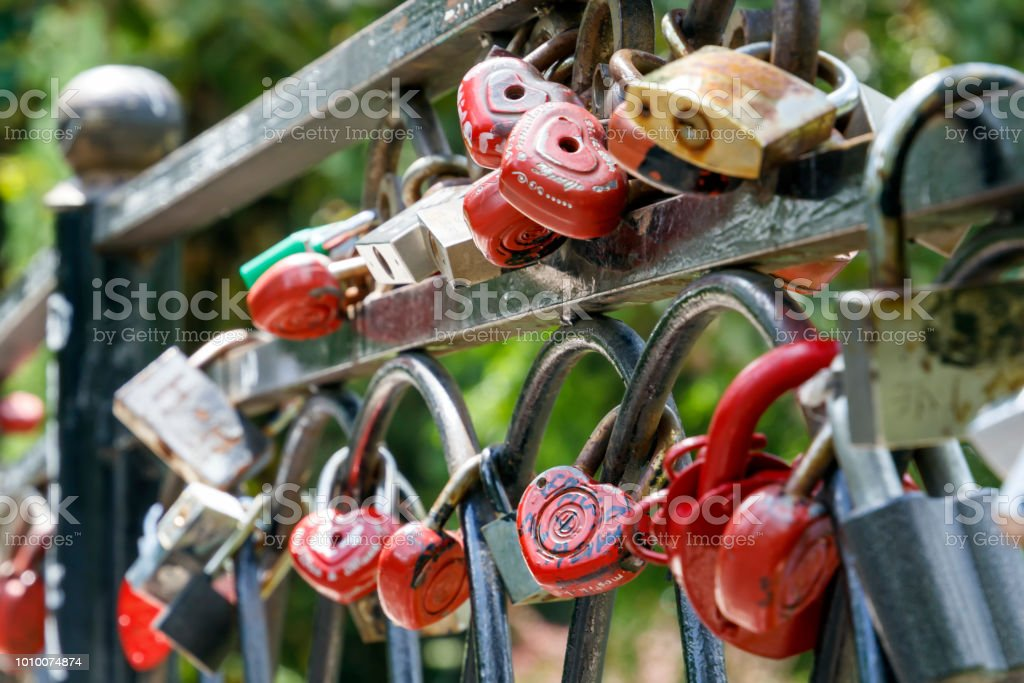 Red Locks Of Love Hang On The Bridge As A Symbol Of Happiness And An
