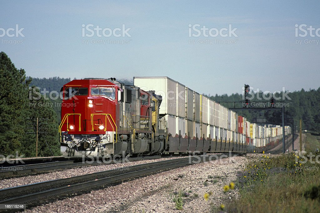 Red locomotive and double stack freight train stock photo