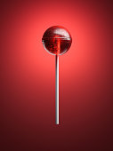 Red lollipop isolated on bright background. 3d rendering