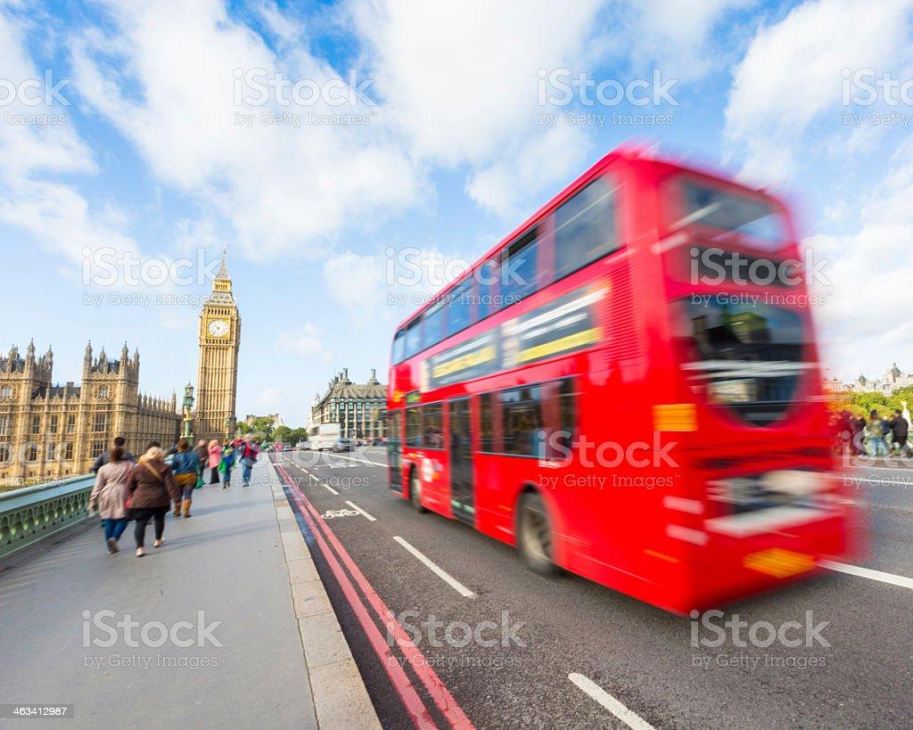 Red London double-decker bus driving towards Big Ben stock photo