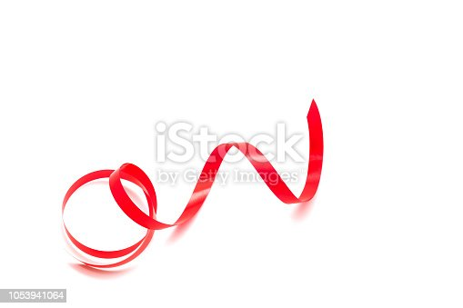 istock Red long wave ribbon for decor card or present product concept isolated background. 1053941064