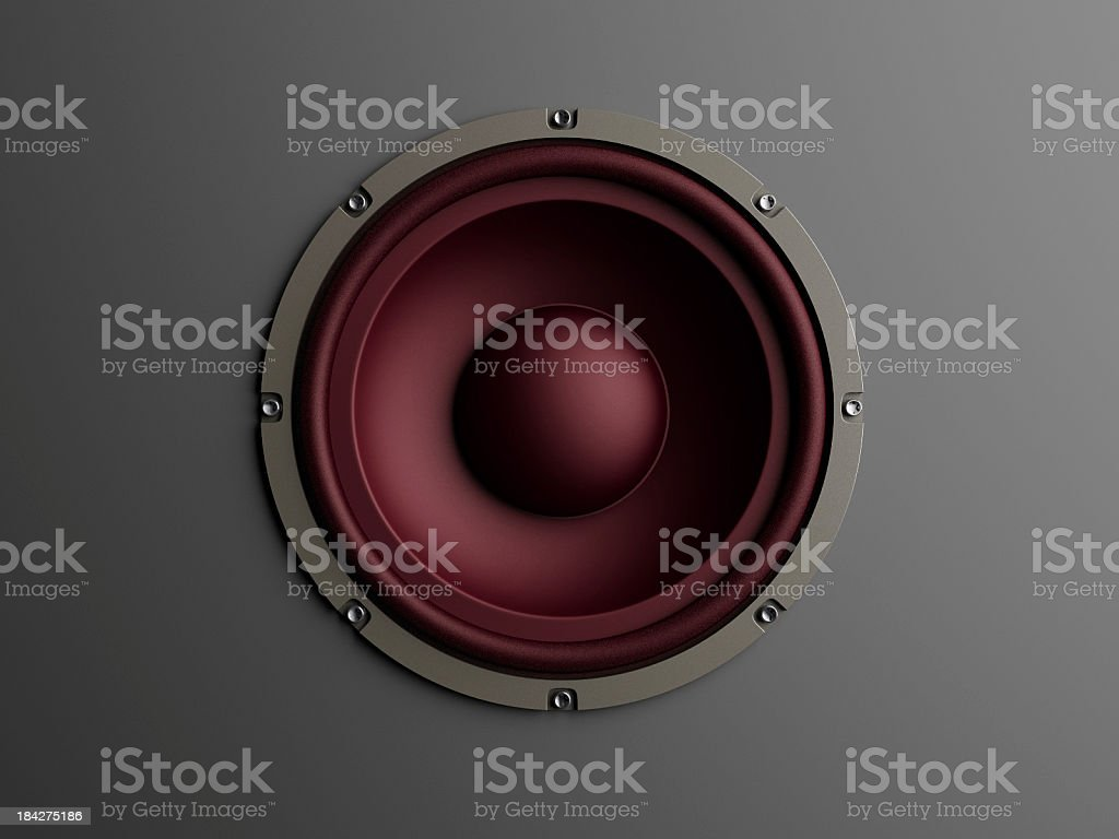 Red loudspeaker on grey background stock photo
