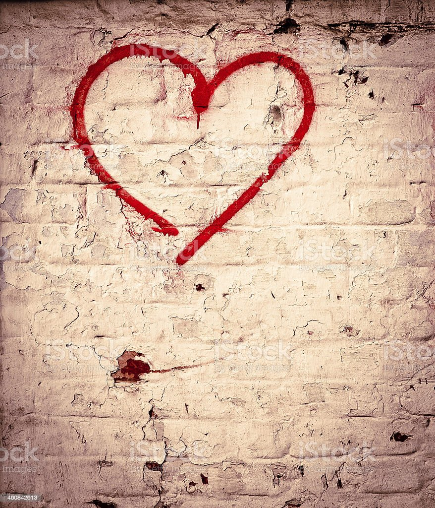 Red Love Heart hand drawn on brick wall textured background stock photo