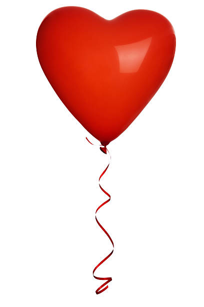 A red love heart shaped balloon against a white background stock photo