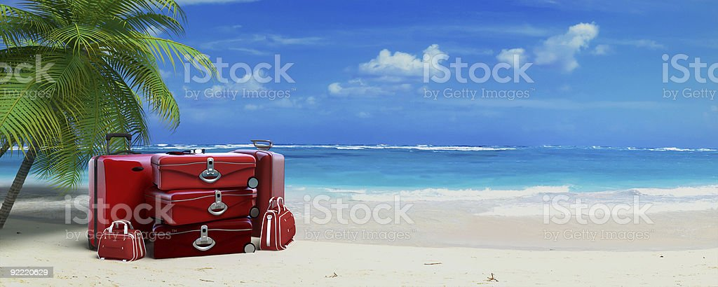 Red luggage in tropical beach stock photo