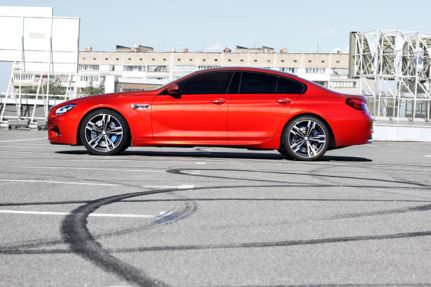 Red luxury BMW M6 in the city. Red BMW M6 stock photo