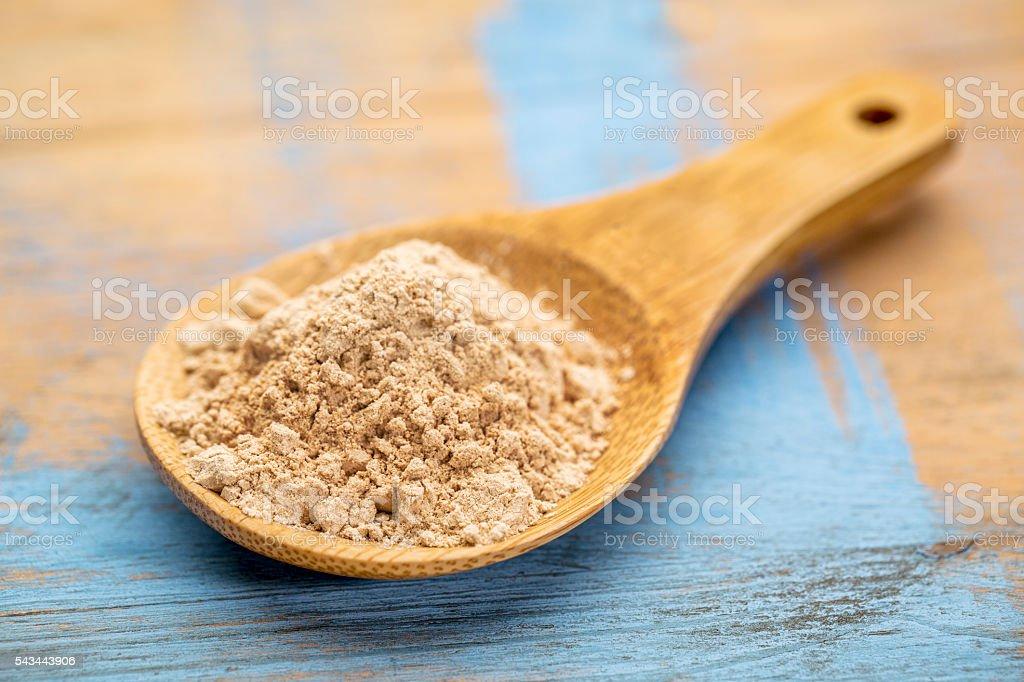 red maca root powder stock photo