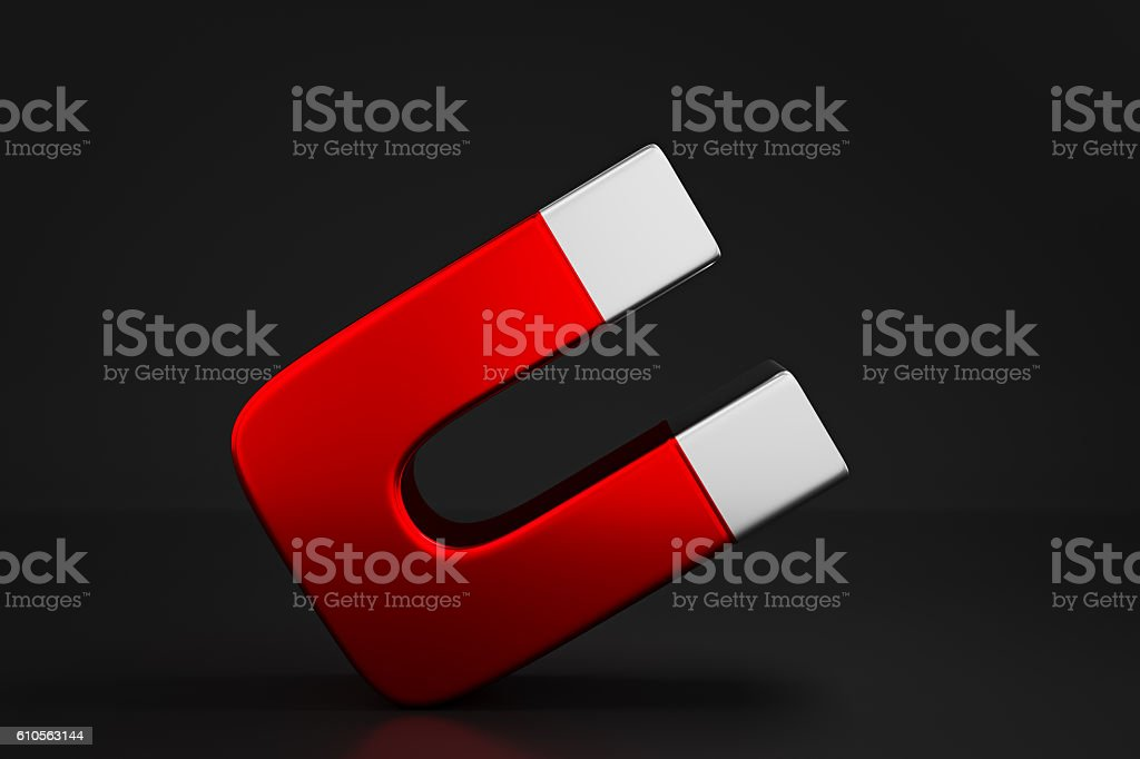 red magnet isolated black background stock photo