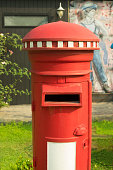 Ancient red mail post box on outdoor location.