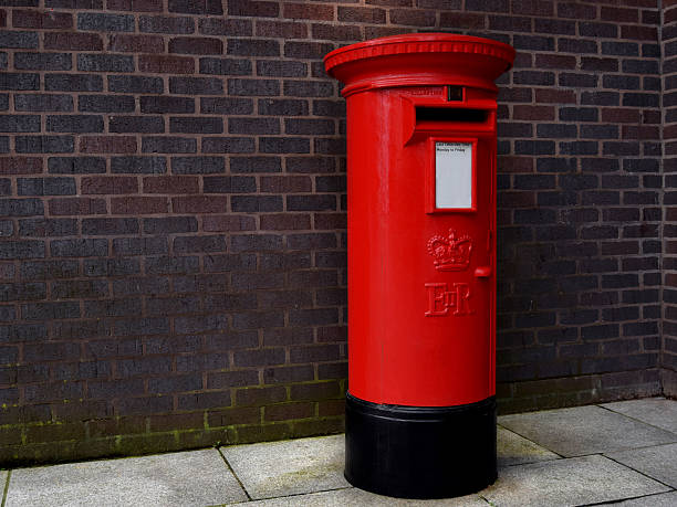 Red mailbox in Birmingham city center stock photo