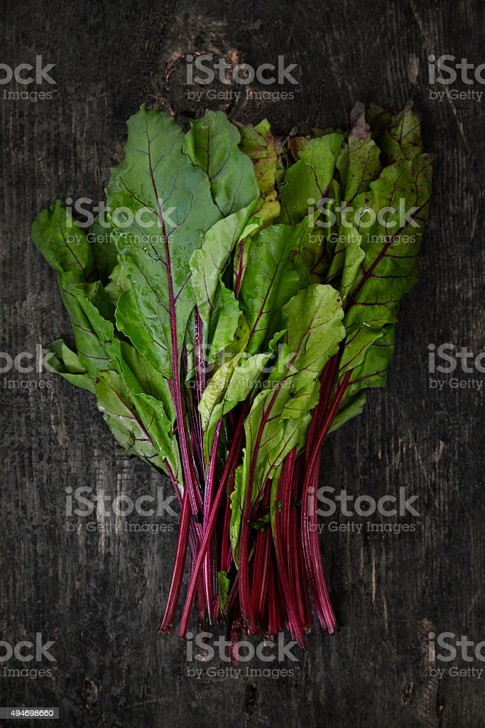 Red Mangolds on dark wooden background stock photo