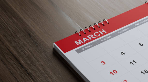 red march 2019 calendar on  brown wood surface - marzo foto e immagini stock