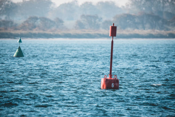 Red marker buoy Red marker buoy floating in the sea fehmarn lateral surface stock pictures, royalty-free photos & images
