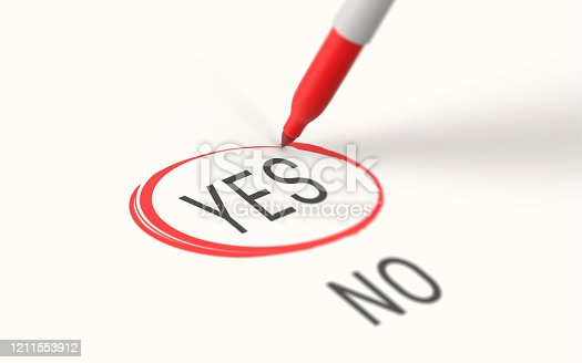 A red marker highlights, selects and marks Yes on white paper while there's a No choice as well.