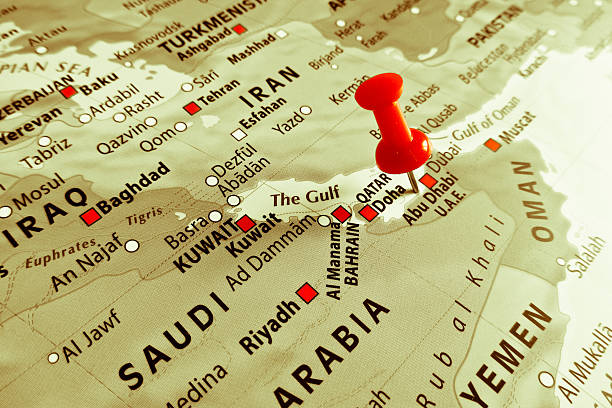 red marker over abu dhabi - kuwait currency stock photos and pictures