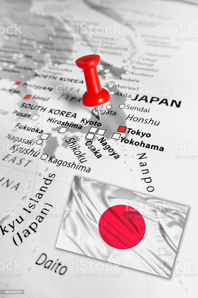 Red marker over Japan with national flag stock photo