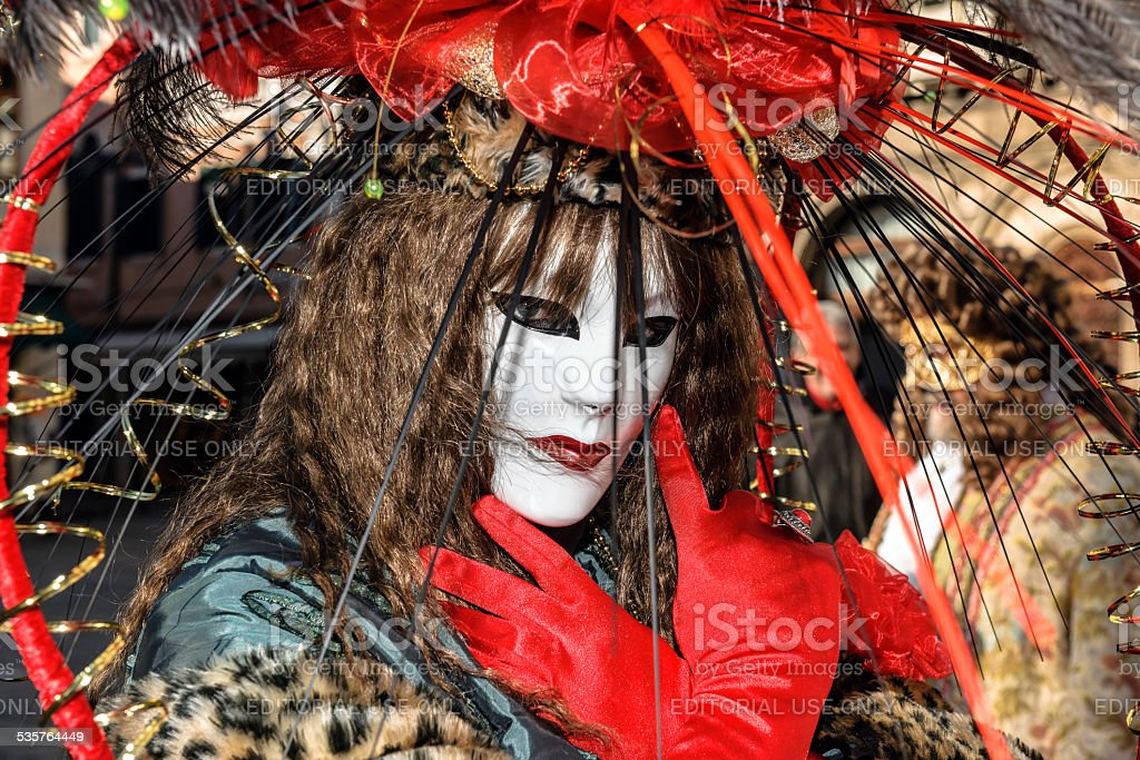 Red mask Venice Carnival 2013 St Mark's Square Italy stock photo