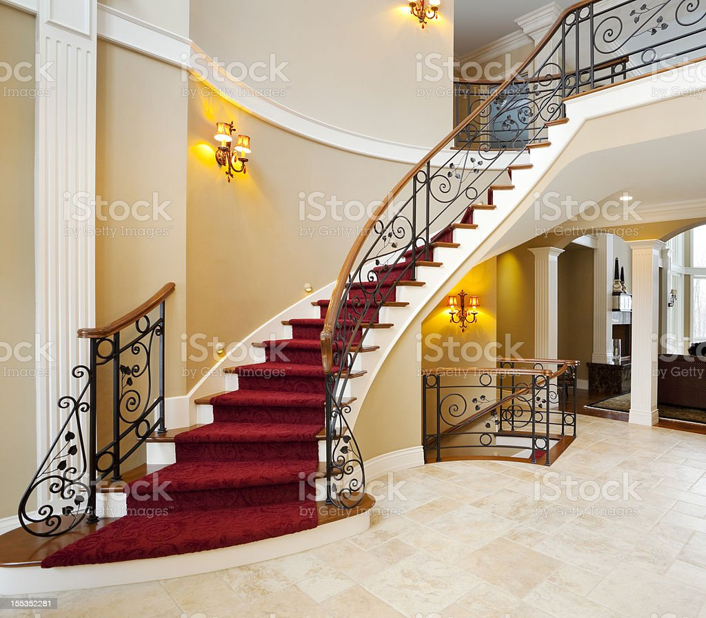 Red Master Staircase in Mansion Grand Foyer stock photo