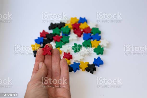 Red meeple small figure of man in hand on white background with picture id1067045768?b=1&k=6&m=1067045768&s=612x612&h=imq8at4p1ll111dlvgowelwwz879vwzqvobp bjv1eg=