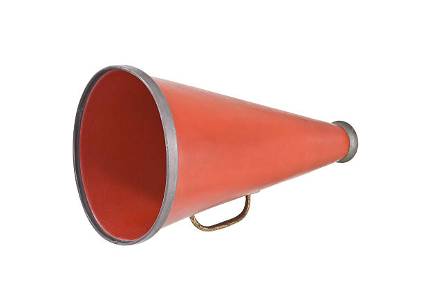 Red megaphone against a white background stock photo