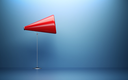 istock Red Megaphone  In Front Of Blue Wall 1144622898