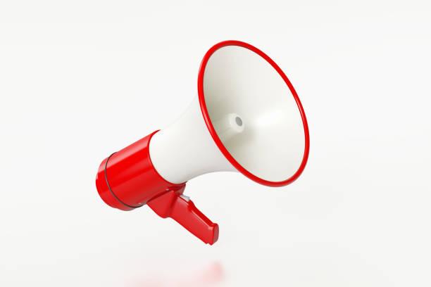 red megaphone on white background - megafono foto e immagini stock