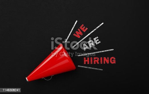 1155191162 istock photo Red Megaphone With We Are Hiring Text Over Blackboard 1146308241