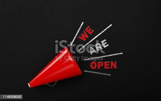 1155191162 istock photo Red Megaphone With We Are Open Text Over Blackboard 1146308332