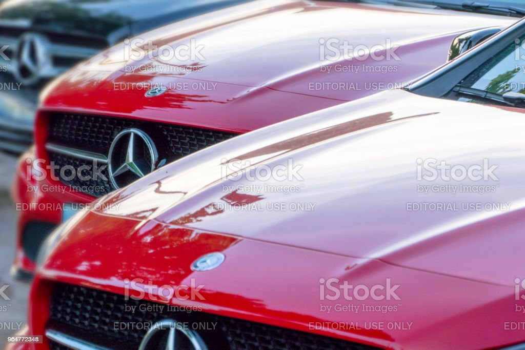 Red Mercedes-Benz vehicles at a public dealership royalty-free stock photo