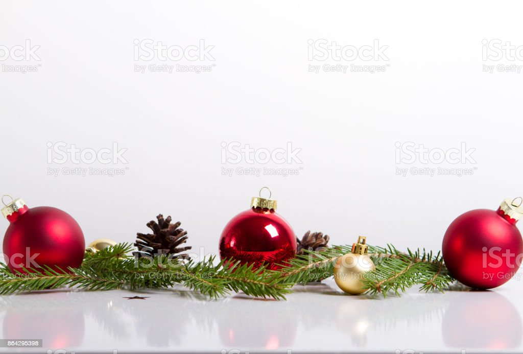 Red merry christmas ornaments and xmas tree on white royalty-free stock photo