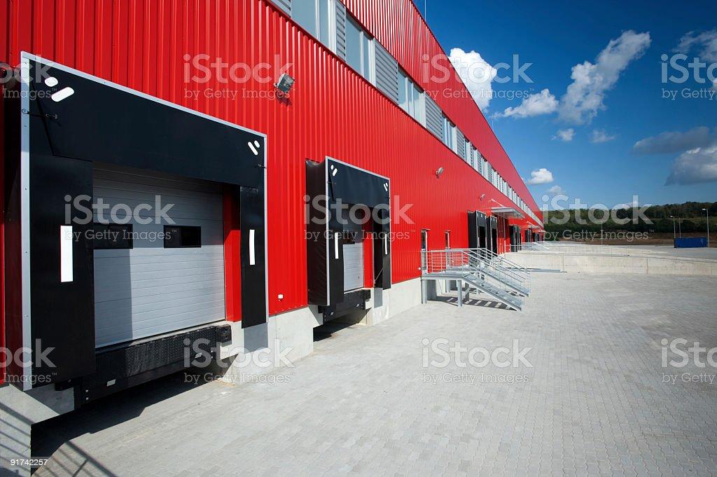 Red metal facade on modern warehousing unit stock photo