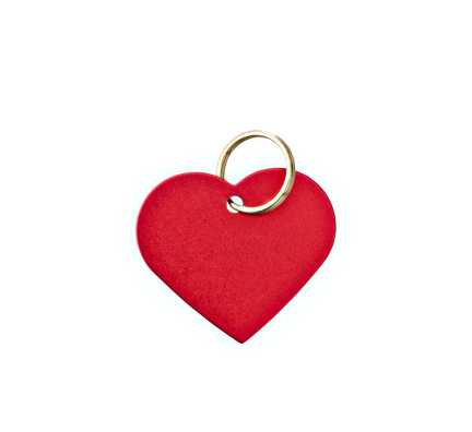 Closeup of a red metal heart-shaped tag with clipping path.  Blank for your text.