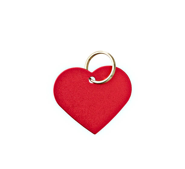 Red metal heart-shaped tag Closeup of a red metal heart-shaped tag with clipping path.  Blank for your text. collar stock pictures, royalty-free photos & images