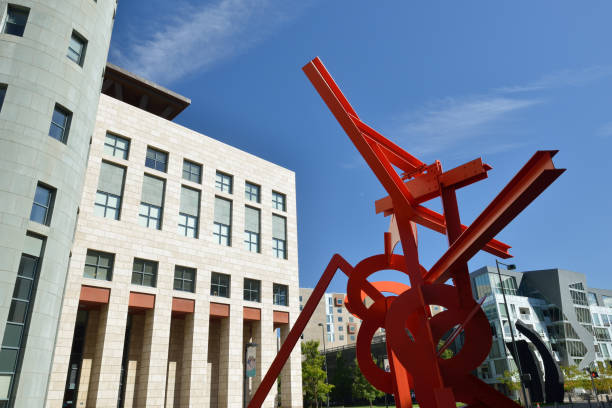 Red metal Lao Tzu sculpture and modern architecture at Civic Center Cultural Complex in downtown Denver stock photo
