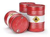 Red metal oil barrels isolated on white background. Oil, gas and petroleum industry and manufacturing.