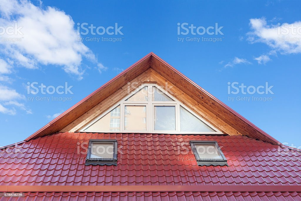 Red Metal tiled. Roof Windows, Skylights and Roof Protection. stock photo