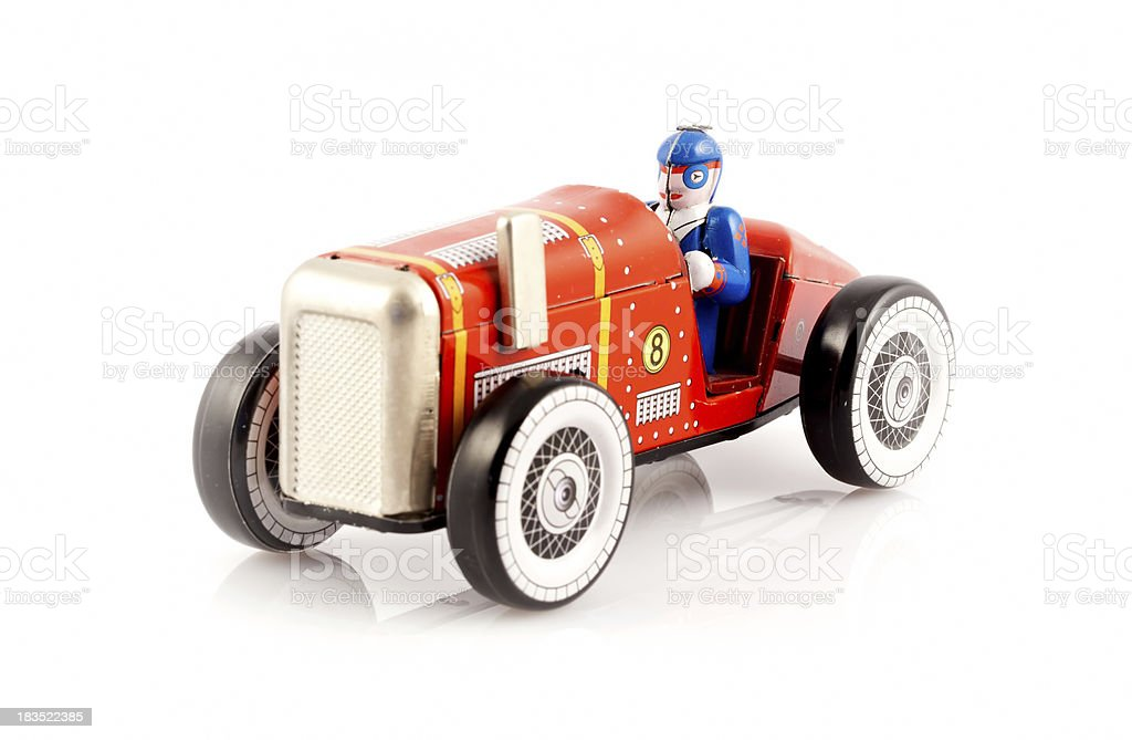 Red metal toy car with driver royalty-free stock photo