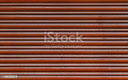 638964834istockphoto Red metal wall 1185262013