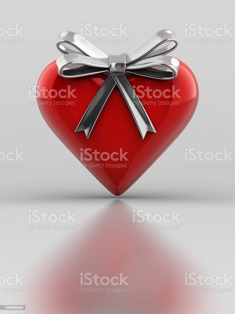 Red Metalic Heart with ribbon stock photo