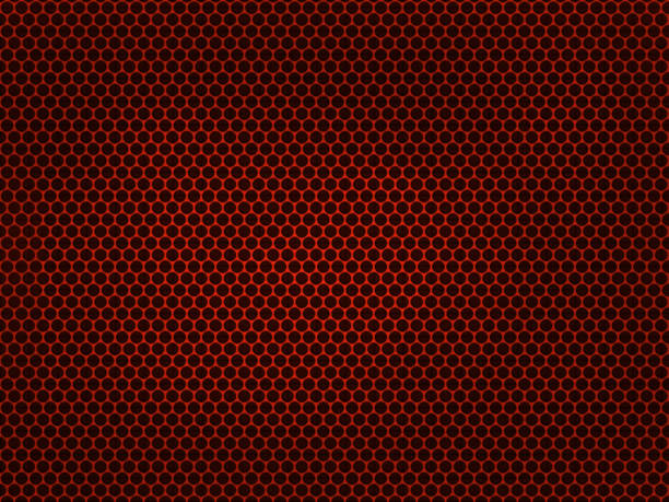 Red metallic grid on black background. stock photo