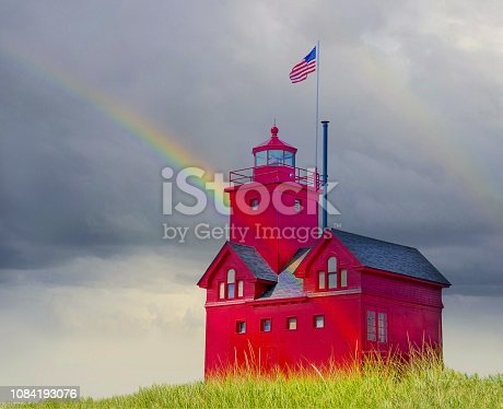 istock red Michigan lighthouse and rainbow 1084193076