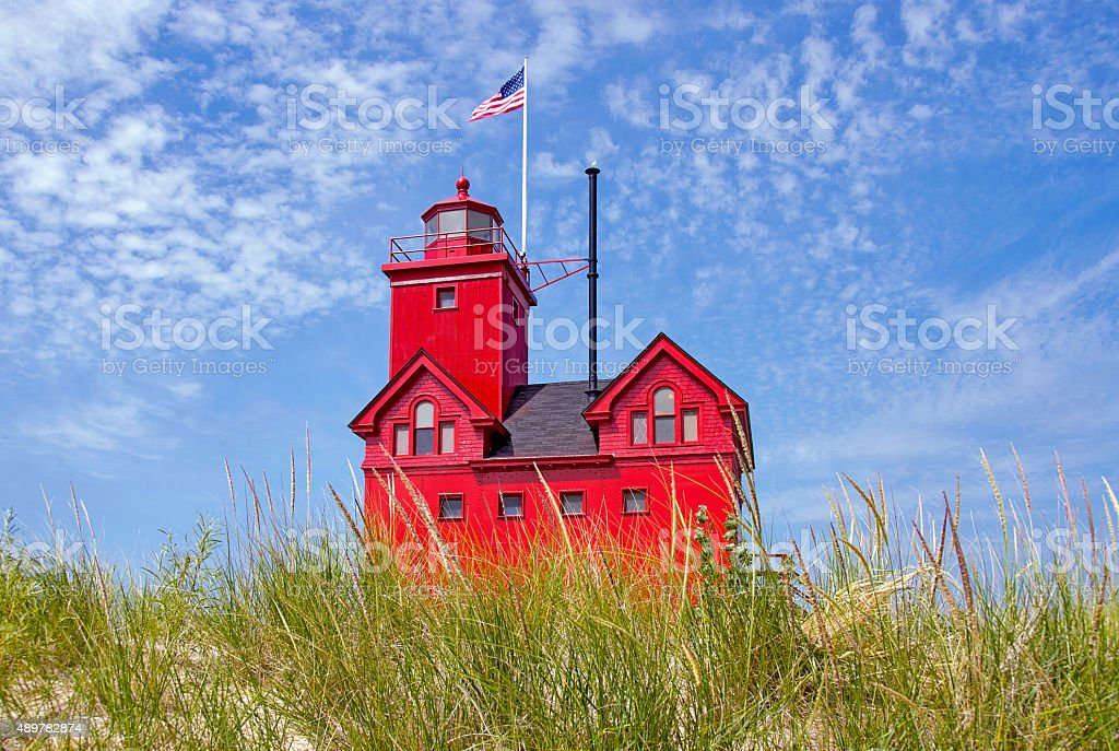 red Michigan lighthouse stock photo
